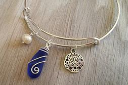 Handmade in Hawaii, wire wrapped cobalt blue sea glass brace