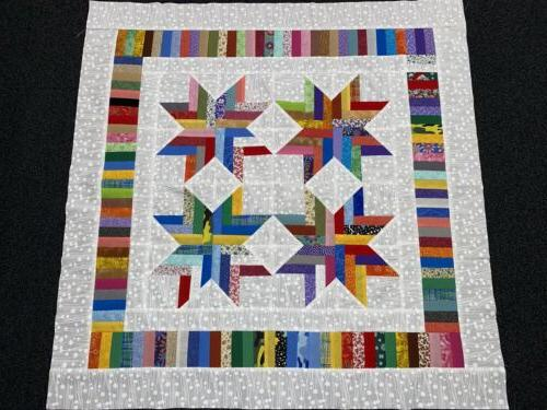 scrappy quilt top for baby lots of